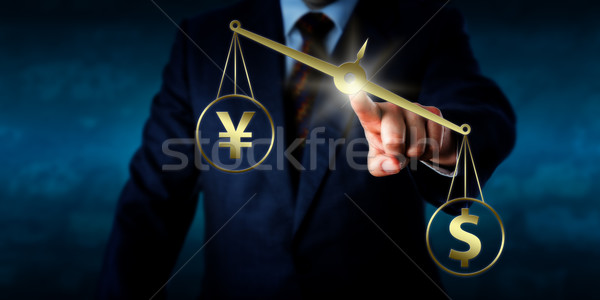 US Dollar Outweighing The Yuan On A Golden Scale Stock photo © leowolfert