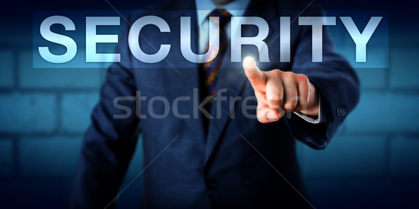 Executive Pressing SECURITY Button Onscreen Stock photo © leowolfert