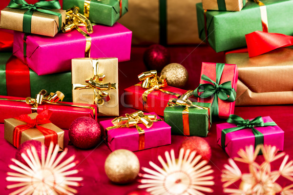 Numerous Xmas Gifts Arranged on a Red Cloth Stock photo © leowolfert