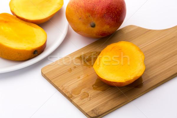 Juicy Mango Slice On A Wooden Cutting Board Stock photo © leowolfert