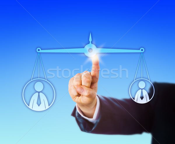 Balancing A Heavy Versus A Light Male Worker Stock photo © leowolfert