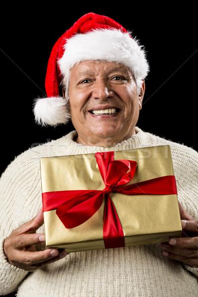 Man aanbieden gouden aanwezig vrolijk Stockfoto © leowolfert