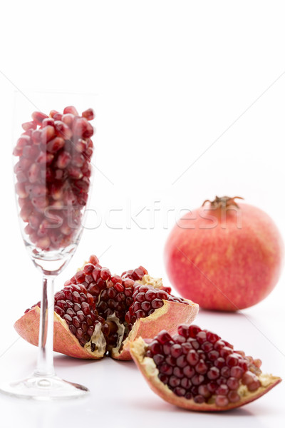Pomegranate seeds and a whole Punica granatum Stock photo © leowolfert