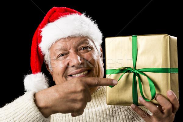 мужчины указывая подарок Сток-фото © leowolfert