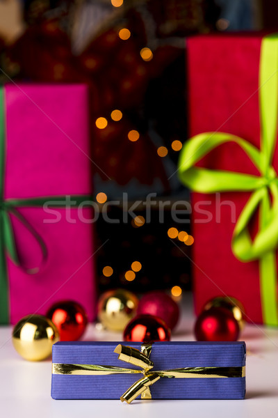 Baubles, twinkles and three wrapped gifts Stock photo © leowolfert