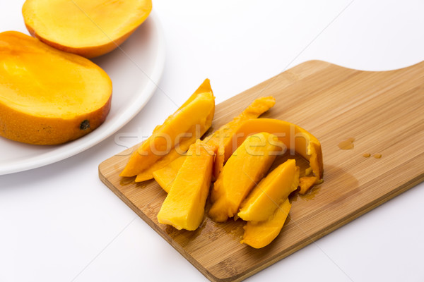 Mango Fruit Pulp And Its Peel On A Cutting Board Stock photo © leowolfert