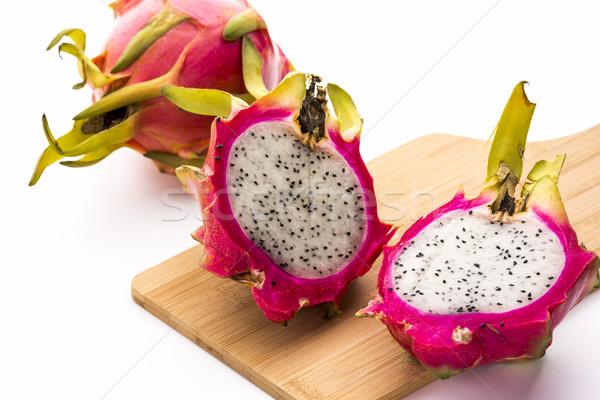 Two Pitaya Halves And A Whole Dragonfruit Stock photo © leowolfert
