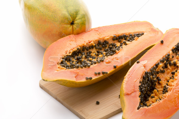 Papaya Halved With A Longitudinal Cut Stock photo © leowolfert
