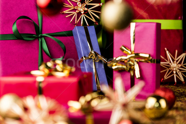 Christmas Presents amidst Baubles and Stars