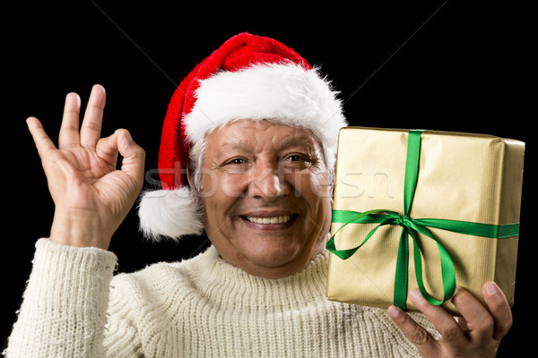 Mężczyzna starszy dar Zdjęcia stock © leowolfert