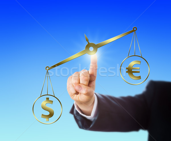 Dollar Outweighing The Euro On A Golden Scale Stock photo © leowolfert