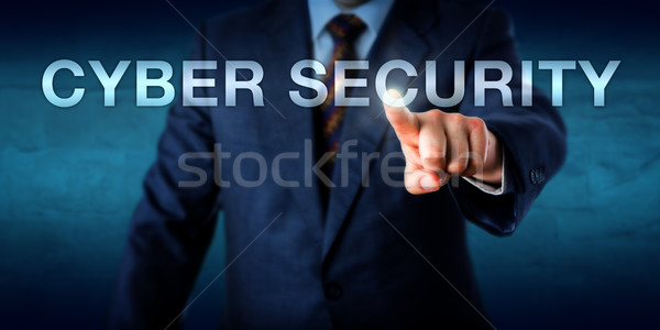Manager Touching CYBER SECURITY Onscreen Stock photo © leowolfert