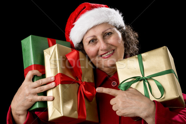 Elderly Woman with Three Wrapped Christmas Gifts Stock photo © leowolfert