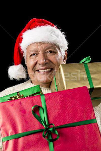 Aged Gentleman Peering Across Three Wrapped Gifts Stock photo © leowolfert