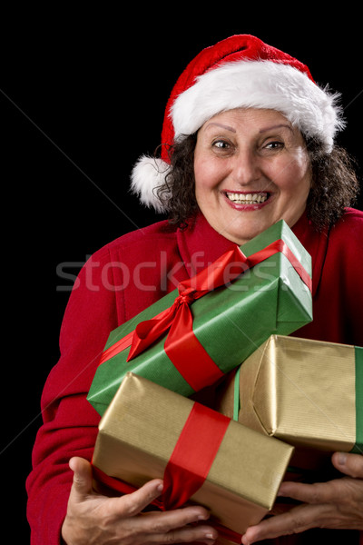 Cheerful Old Lady Offering Three Wrapped Gifts  Stock photo © leowolfert