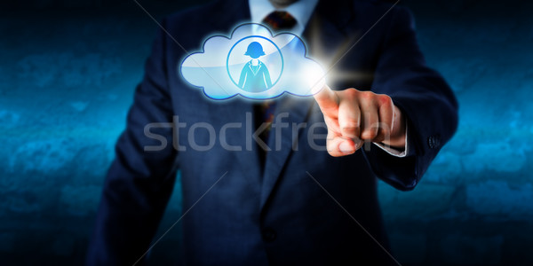 Manager Connecting With Female Peer Via The Cloud Stock photo © leowolfert