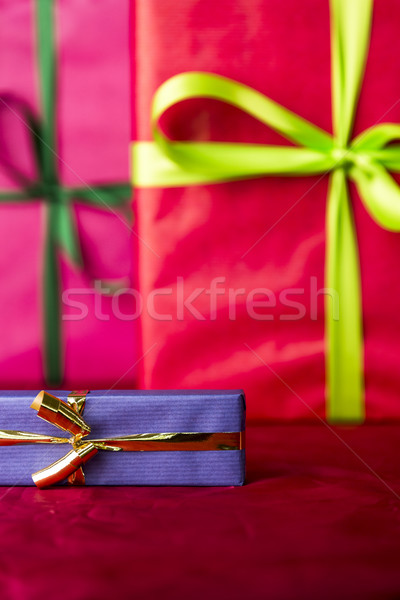 Blue present on red Stock photo © leowolfert