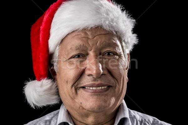 Venerable Man with Red Father Christmas Cap Stock photo © leowolfert