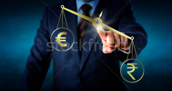 Indian Rupee Outbalancing The Euro Currency Sign Stock photo © leowolfert