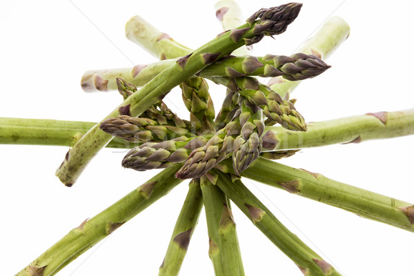 Spiral-Shaped Stack of Green Asparagus Spears Stock photo © leowolfert