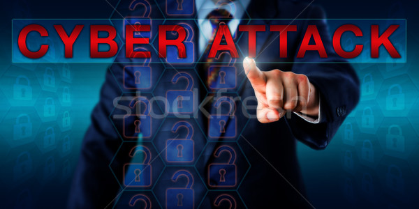 Hacker Touching The Warning CYBER ATTACK Onscreen Stock photo © leowolfert