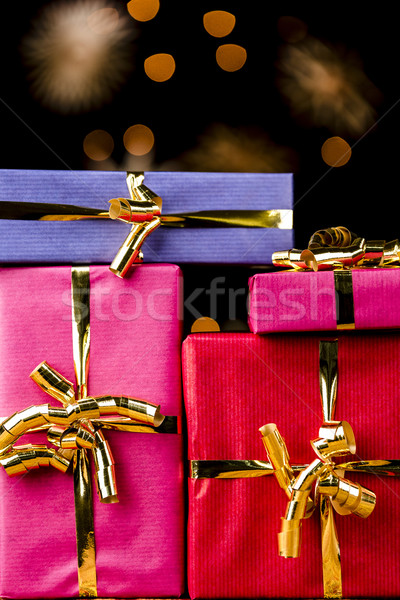 Four Single-Colored Gifts with Golden Bows