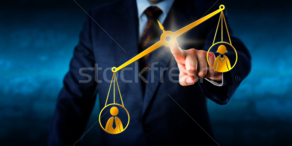 Male Worker Outbalancing A Female White Collar  Stock photo © leowolfert