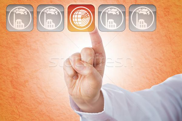 Index Finger Pushing Geothermal Energy Button Stock photo © leowolfert