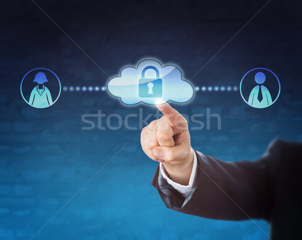 Touching Locked Cloud Linked To Two Office Workers Stock photo © leowolfert