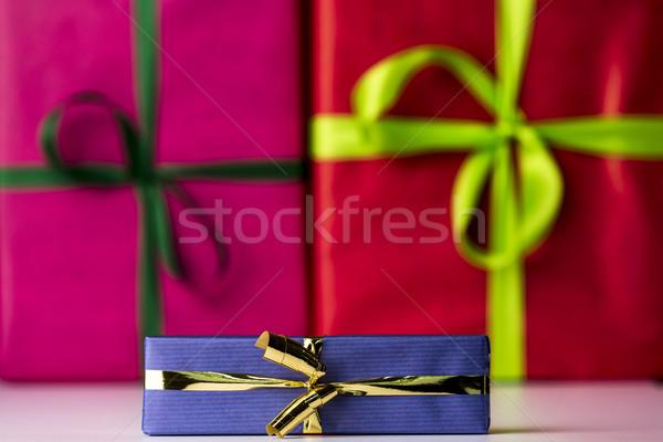 Three bowknots tied around gifts Stock photo © leowolfert