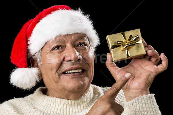 Aged Man With Emphatic Look And Golden Gift Stock photo © leowolfert