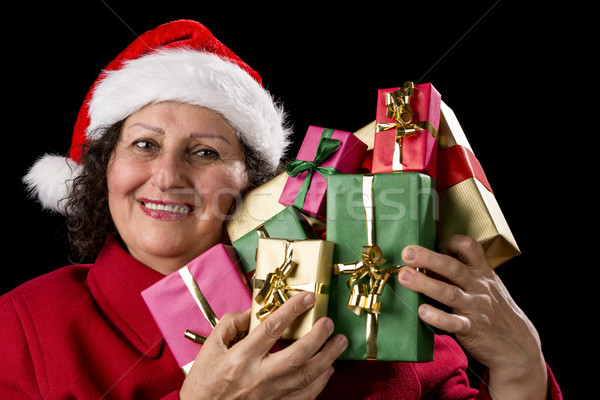 Smiling Old Woman is Holding Seven Wrapped Gifts