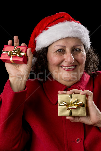 Happy Old Woman with Santa Hat and Two Xmas Gifts Stock photo © leowolfert