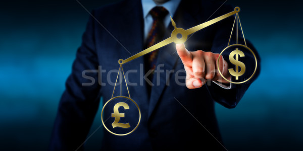 Stock photo: British Pound Sterling Outweighing The US Dollar