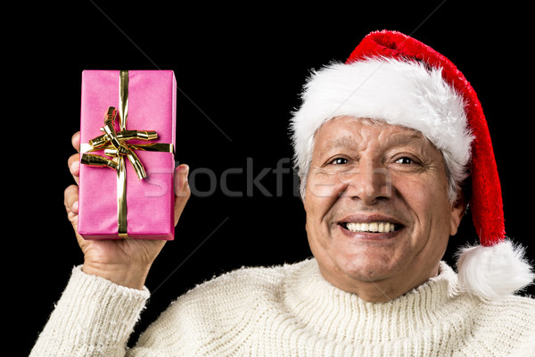 Merry Old Man Showcasing A Pink Wrapped Present Stock photo © leowolfert