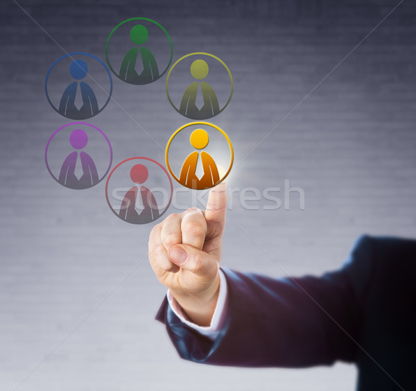 Choosing One Of Six Differently Colored Workers Stock photo © leowolfert