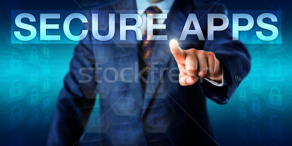 Entrepreneur Selecting SECURE APPS Onscreen Stock photo © leowolfert