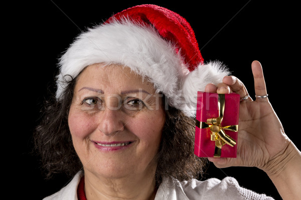 Venerable Woman with Red Cap Holding Small Gift Stock photo © leowolfert