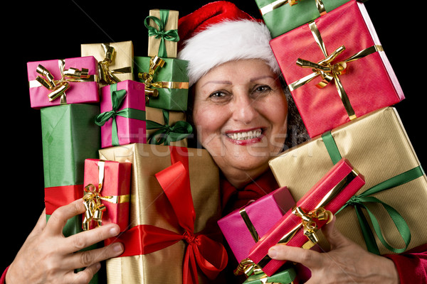 Delighted Aged Woman Embosoming Wrapped Presents