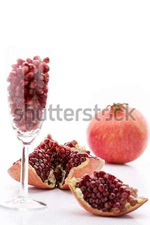 Pomegranate, whole and broken-up Stock photo © leowolfert