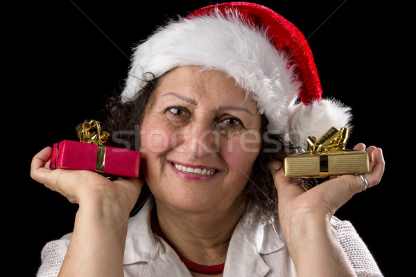 Gentle Aged Woman Holging Two Small Gifts Stock photo © leowolfert