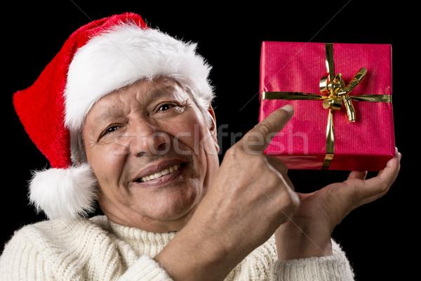 Männlich Senior Hinweis rot Weihnachten Geschenk Stock foto © leowolfert