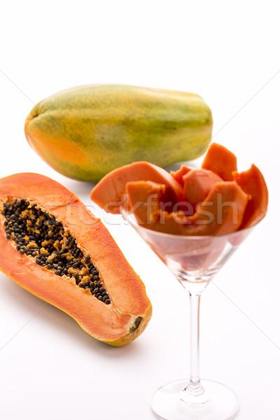 Papaya - a globose, green and yellow fruit Stock photo © leowolfert