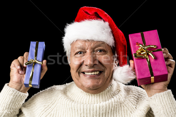 Euphoric Old Man With Two Presents And Santa Hat Stock photo © leowolfert