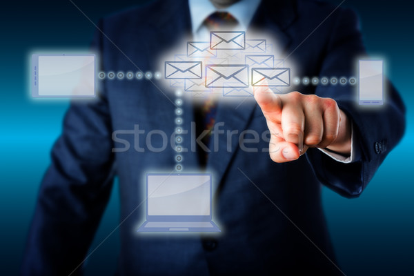 Manager Touching A Host Of Emails In Cloud Network Stock photo © leowolfert