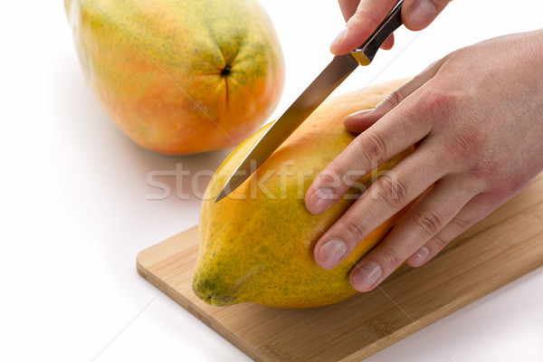 Knife Positioned For A First Cut Through A Papaya Stock photo © leowolfert