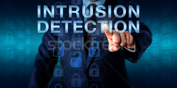 Security Expert Pushing INTRUSION DETECTION Stock photo © leowolfert