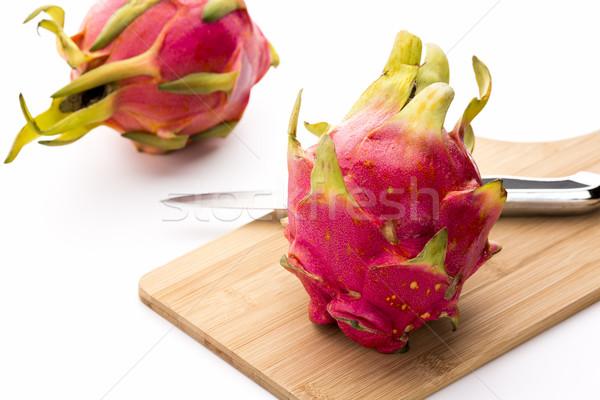Two Pitayas, One Kitchen Knife And A Cutting Board Stock photo © leowolfert