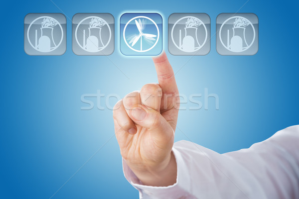 Finger Selecting Wind Energy Among Nuclear Icons Stock photo © leowolfert