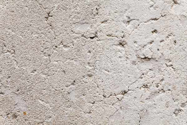 Close Up On Opened-up Cracks In Exterior Wall Stock photo © leowolfert